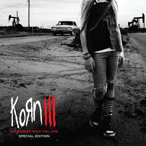 Korn Holding All These Lies cover