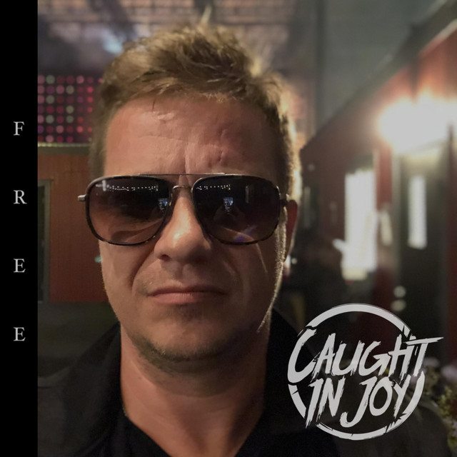 Album cover for Free by Caught in Joy