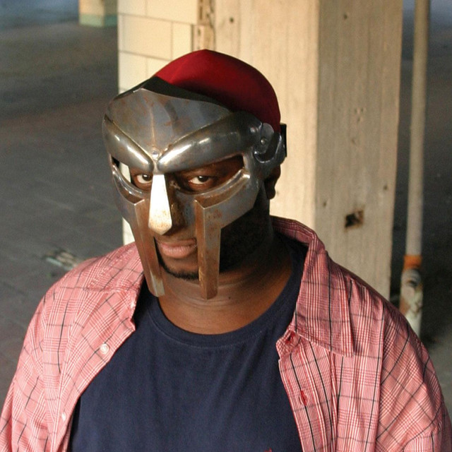 Photo of MF Doom wearing his metal face mask