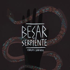 Besar a la Serpiente - Carlos Sadness