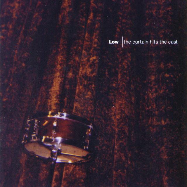 Skivomslag för Low: The Curtain Hits The Cast