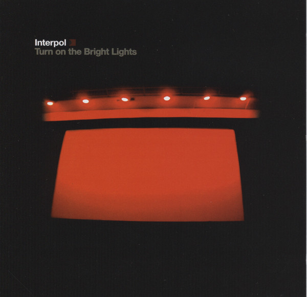 Album cover for Turn On The Bright Lights by Interpol